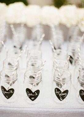 personalized mason jars as escort cards & wedding favors