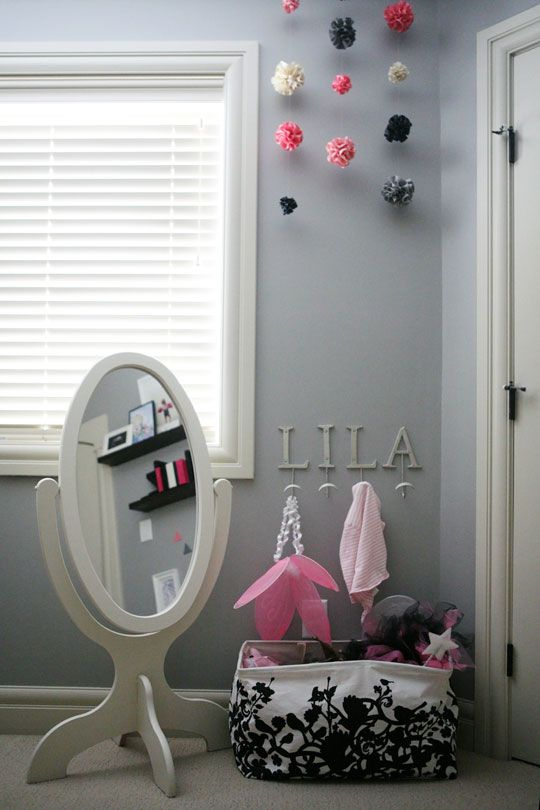 Love this set up. Little girl's mirror and all her dress up clothes ready to go in a stylish dress up bin. (bin by Umbra)