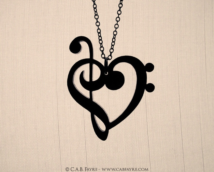 Treble & Bass Clef Heart Necklace - Laser Cut Acrylic - Music Notes. $15.00, via Etsy.