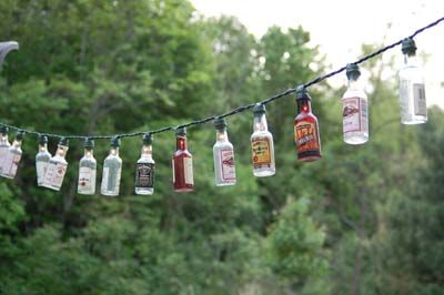 patio lights made out of mini liquor bottles ...  Is decorating now a reason to drink more?