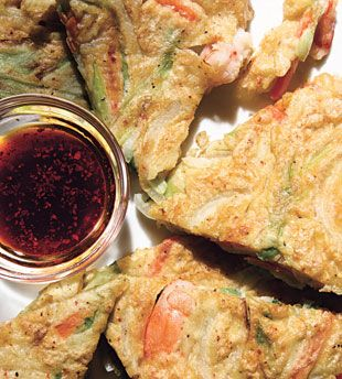 Shrimp and Green Onion Pancakes  Haemul pa jeon—savory pancakes that are crispy outside and soft and tender inside—are a popular side dish. They're best served warm, then dipped in a sauce of soy, lemon, and sesame.