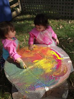 """ART Activity: """"Bubble Wrap Paint and Explore!"""" Great sensory/texture activity! Can be done indoors or outdoors, just cover and stick bubble wrap over table and pour some paint... Children might need encouragement running their fingers over the bubble wrap at first, but soon they will love the new experience! For a more process-oriented activity provide different objects for children to explore the paint with, such as soft sponges, scrubbing sponges, plastic flowers, toy cars, etc."""