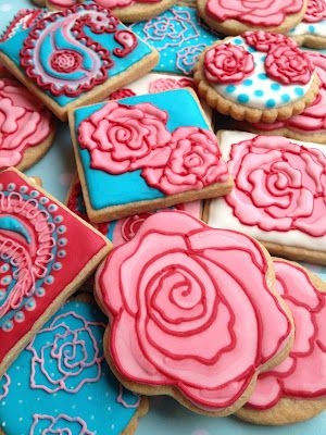 Sweet Rose and Paisley Cookies dercorated with royal icing in pink and blue