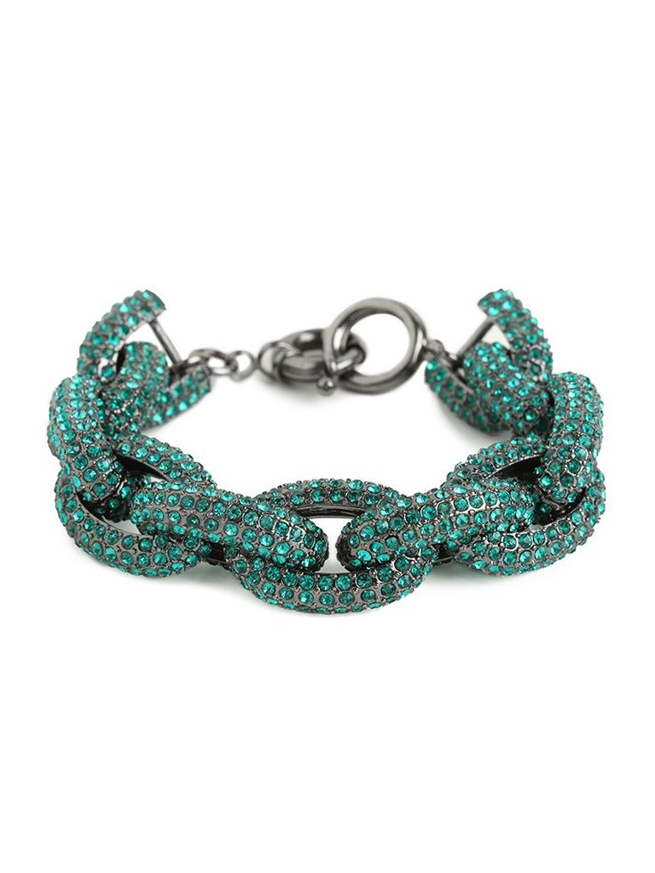 Razzle, dazzle 'em with this striking statement bracelet. It flaunts gorgeous tough-chic chains - in audacious, amped-up proportions - that come covered in sparkling emerald-colored crystals.