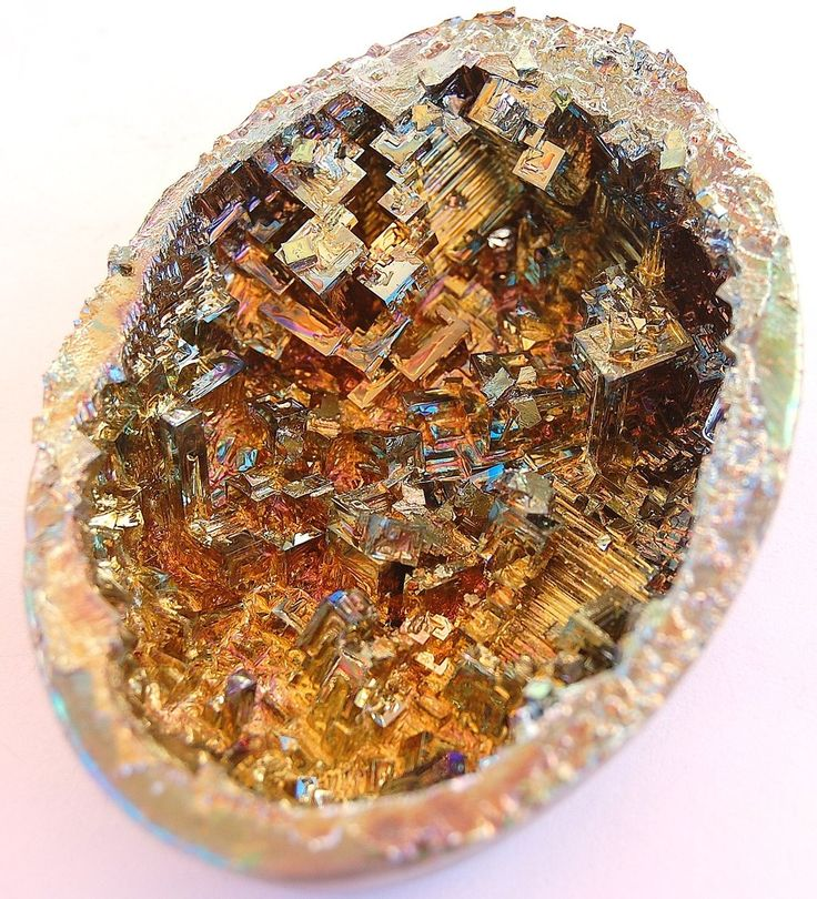 Bismuth Geode/ bismuth that has been grown and cooled in an eggshell! Apparently bismuth is one of the easiest crystals to grow yourself. Bismuth does not naturally occur in geode form. What fun to create your own dragon's egg!