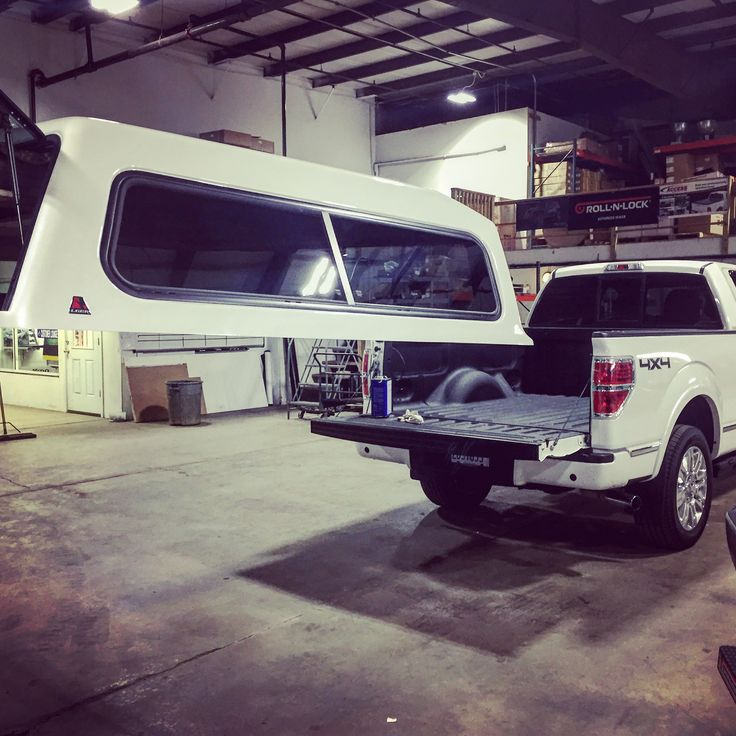 White Ford F150 getting a Leer Truck Topper Cap installed at CPW Truck Stuff in Tinley Park, IL