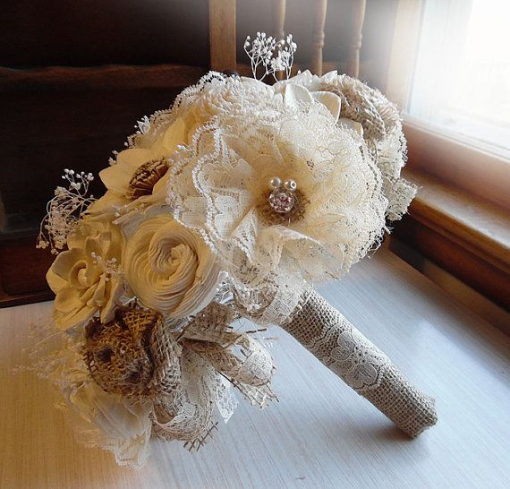 Rustic Lace Flower Shabby Chic Bridal Bouquet with Burlap Roses, Sola Flowers, Rhinestones and Pearls.  Sizes are: small 6 across, has a 20 circumference medium 8 across, has a 26 circumference (shown) large 10 across, has a 30 circumference  Sola flowers are handmade from the tapioca wood peel which is an all natural paper product derived from the tapioca plant. They are light weight, thicker than paper and have a beautiful woody appearance.  For more bouquets see: https://www.etsy...
