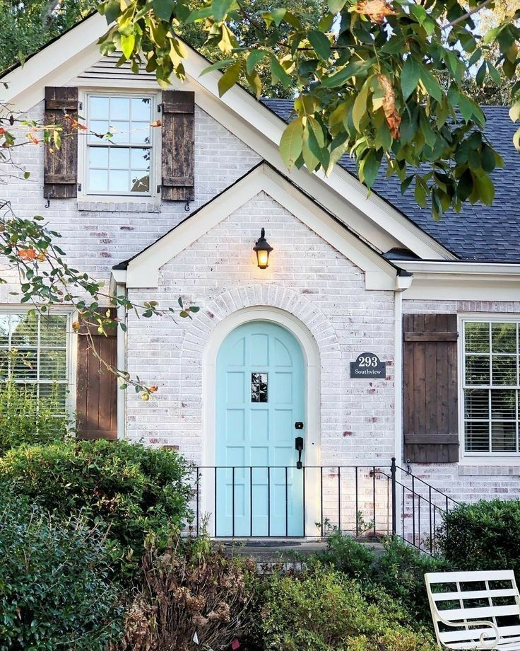 White Washed Brick Brown Shutters Blue Door Exterior Home Makeover House Exterior Facade House House Designs Exterior