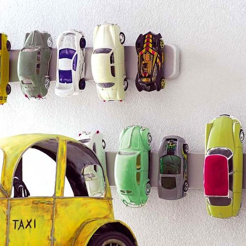 Magnet Strip Car Storage - Boy Room Storage Ideas I love this idea for storing Matchbox cars and Hot Wheels. A magnet strip affixed to the bedroom wall, where cars can be conveniently stored and also add a bit of decor.