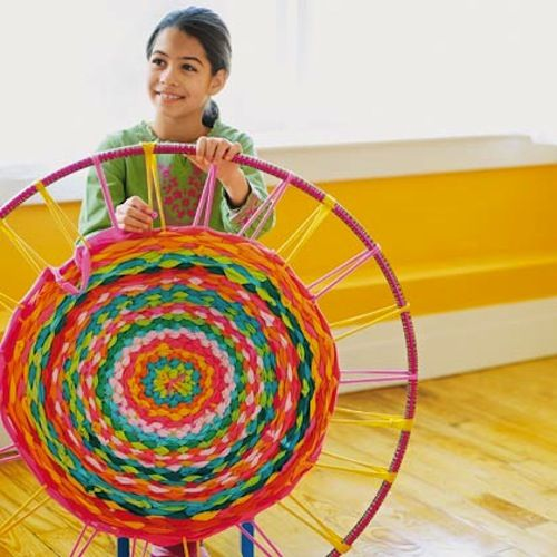 How-To: Weave a Hula Hoop Rug  Ok girls we gotta make these this summer, start saving some t-shirts.