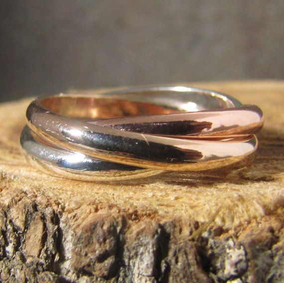 silver copper and gold rolling ring