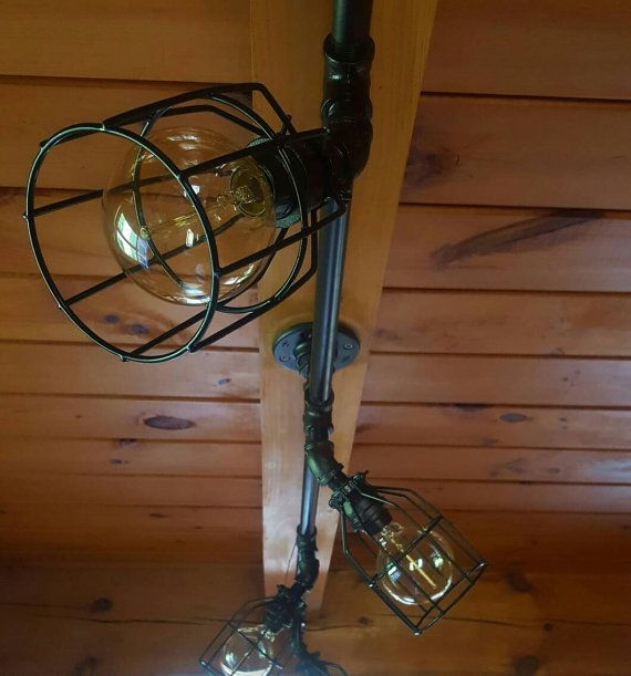 This listing is for a custom made-to-order Rustic Industrial Ceiling Track Light. This light is sturdy, industrial, and can be built to suit your needs. The bulbs shine down at a 45° angle from the bar and they can swivel 360°.   OPTIONS: Use the variations menu above to create your light and contact us with any questions. PRICES VARY WITH NUMBER OF BULBS.  Simply select the number of bulbs you would like. Then, select the amount of drop you would like from the ceiling to the horizontal…