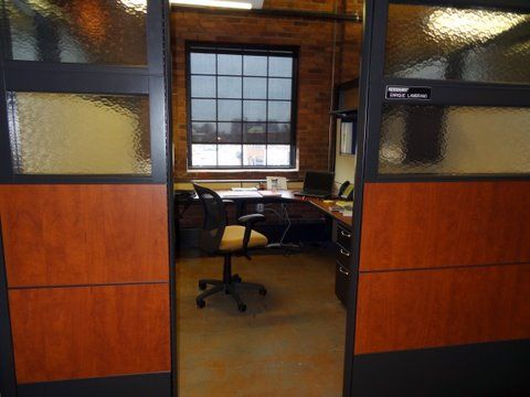 Sophisticated laminate and glass stations for staffing company by connecting elements office cubicles