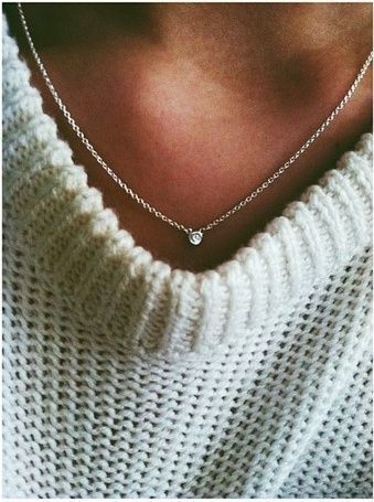A simple and elegant solitaire diamond necklace will add grace to any outfit | @andwhatelse