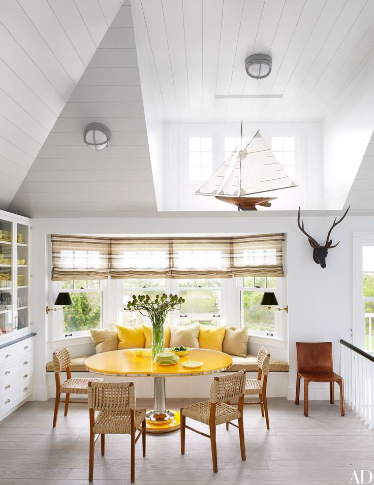 Sun shines in the breakfast area of this Southampton home, which took decorating inspiration from its beach surroundings. | archdigest.com