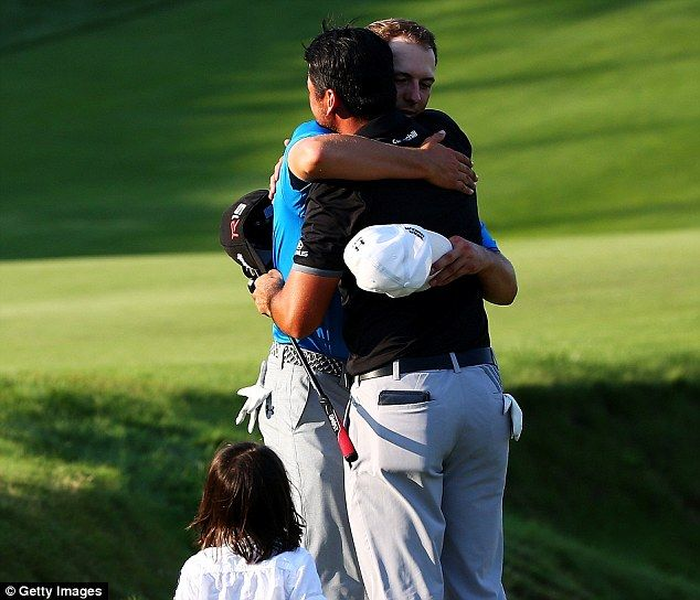 Jordan Spieth congratulated Jason Day on winning while young Dash looked on.