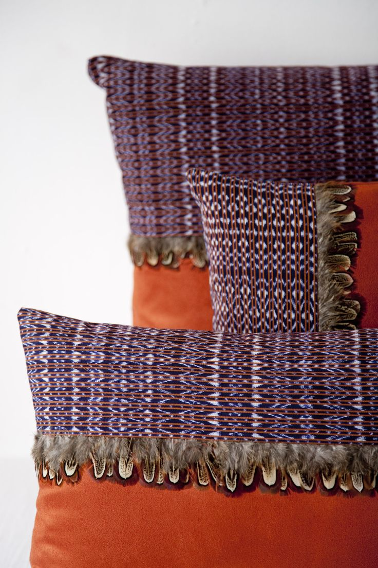 Pillows – Maggie Galton. Hand woven ikat traditional rebozo pillows with feather fringe.