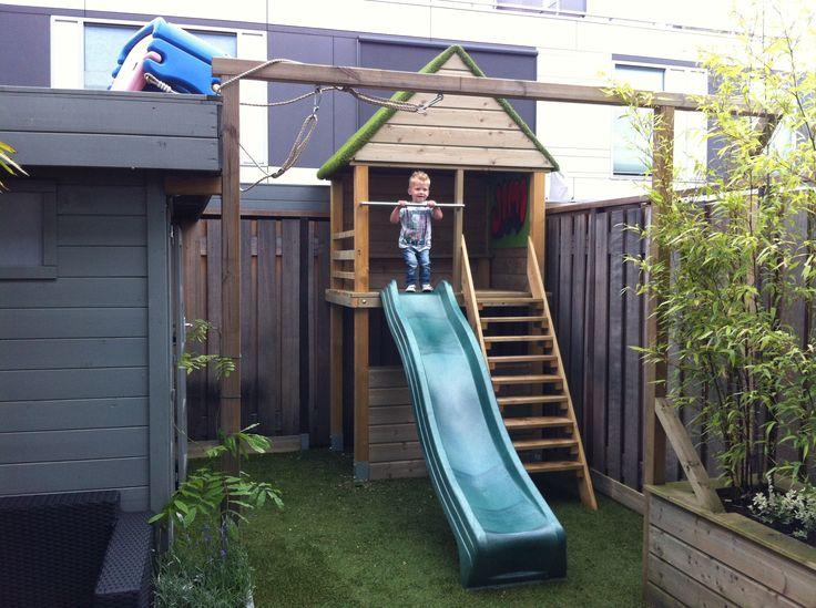 Speelhuis tuin op maat gemaakt incl. glijbaan en bankjes in het huisje boven en beneden  www.project040.nl