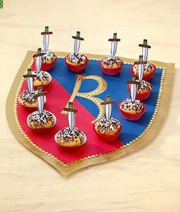 I love this idea for serving cupcakes... we can make wooden crests that could be later hung on the wall as decor.