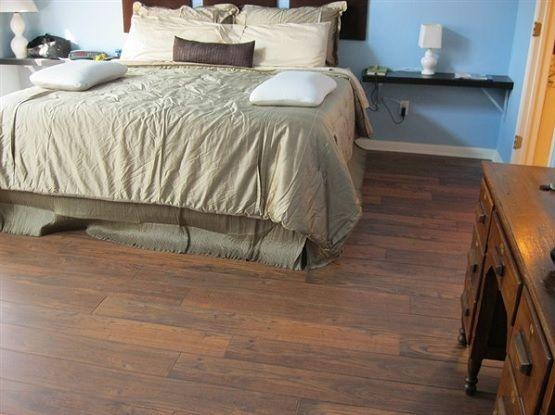bedroom with hand scraped laminate flooring