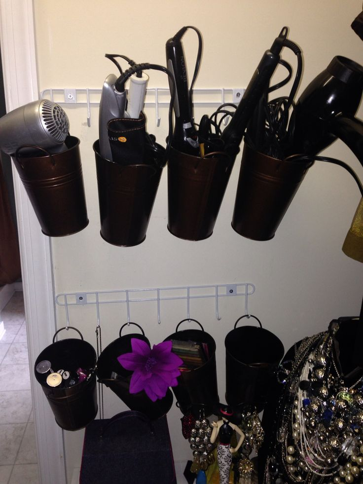 $10 solution to organizing hair dryers, curling irons, & makeup. Hooks $2 and buckets $1 a piece @ the Dollar Tree. The buckets can be labeled.