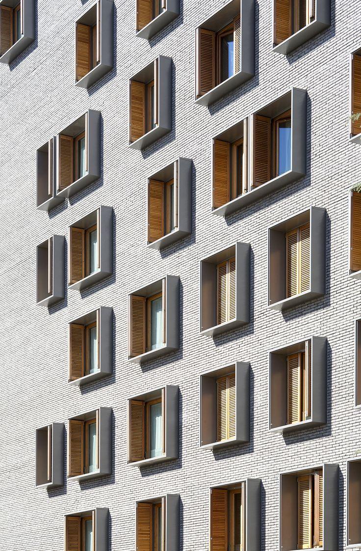 Dezeen: Michel Guthmann kombiniert grauen Ziegel mit Lärche für Pariser Wohnblock