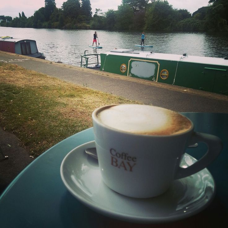 Sipping coffee by the river in kingston