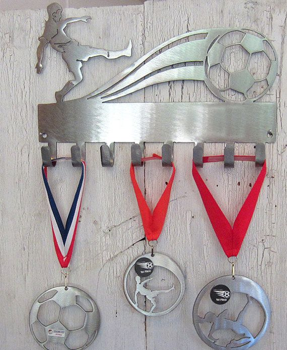 Brand new for 2014-2015, soccer medal display racks. You can rock your medals for all to see on this sturdy, steel race medal display rack.