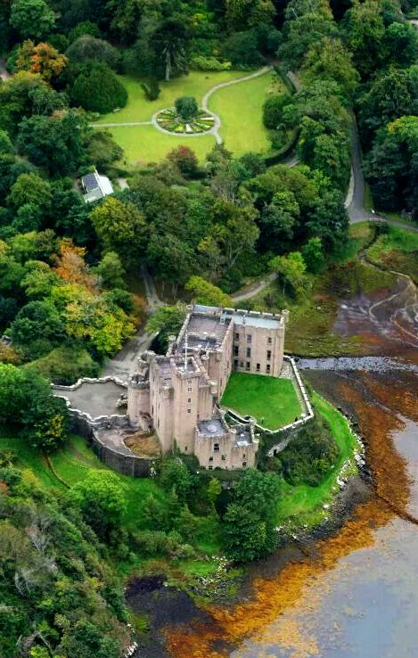 Dunvegan Castle is located on the beautiful Isle of Skye.  It is the seat of the MacLeods. It has been continuously occupied by the chiefs of Clan MacLeod in an unbroken line stretching back for over 7 centuries and 30 generations. Aerial Photograph by Scotavia Images.