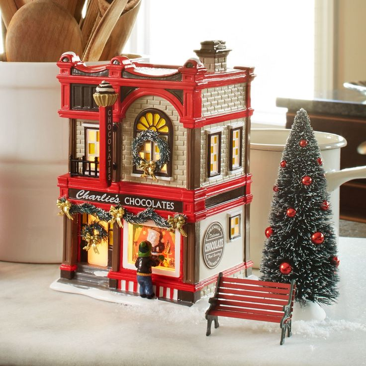 "Snow Village Series Dimensions: 7.65""W x 5.83""D x 4.9""H Department 56#: 4054972 Lighted Building Materials: Zinc alloy, Ceramic, UL Cord, Sisal, Plastic Coordinates With: 4054975 - Snow Village Sidewalk Sweets Electrical:  Standard cord and bulbReplacement Bulb:  56.99244Replacement Cord:  56.99028 Item Details The sweet scent of candy entices everyone on Main Street to stop and smell the chocolates in downtown Snow Village. Unable to resist, a young fellow stops in front to peek inside at…"