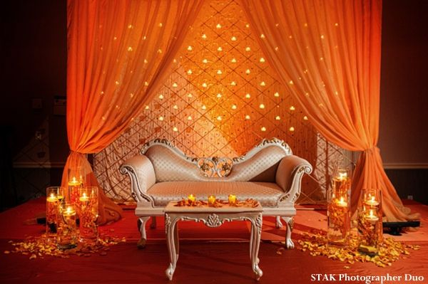 Orange Indian wedding reception decor and stage for Indian bride and groom