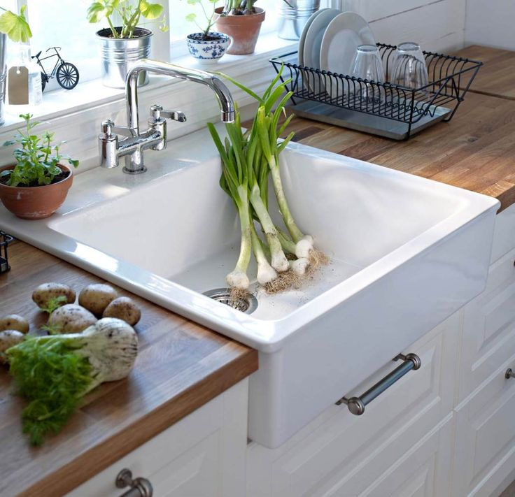 My dream kitchen, right down to the sink and the color of that wood. // Page 50-51 - Ikea Kitchen Dreambook