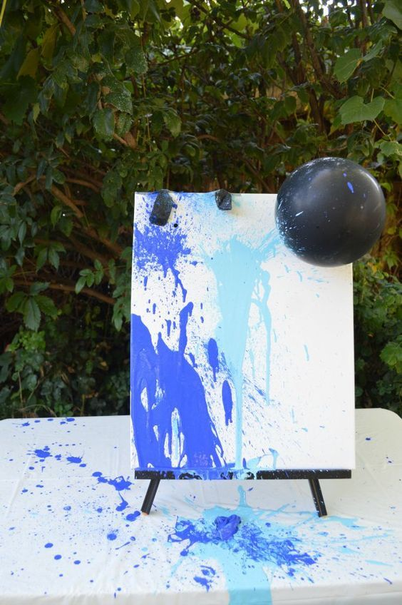 Fun gender reveal idea: Fill balloons up with pink or blue paint and throw darts at the balloons for the grand reveal! Afterwards, you can hang up the canvas in your home as a beautiful piece of artwork!