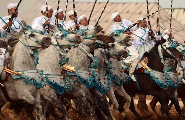 TOPSHOT Moroccan horsemen perform during the 9th edition of the 'Salon du Cheval' in the port city of El Jadida on October 12 2016 / AFP / FADEL SENNA