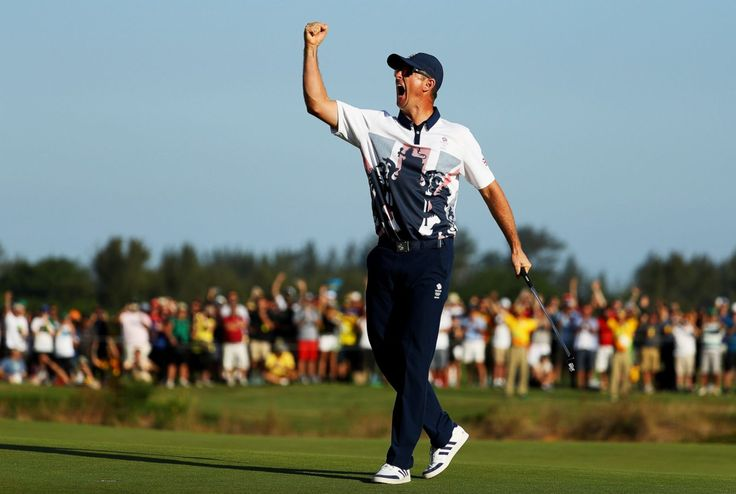 Justin Rose of Great Britain celebrates winning the first men's Olympic golf…