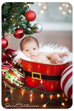 This baby in a bucket but sleeping| 29 babies who totally nailed their first Christmas photos| buzzfeed
