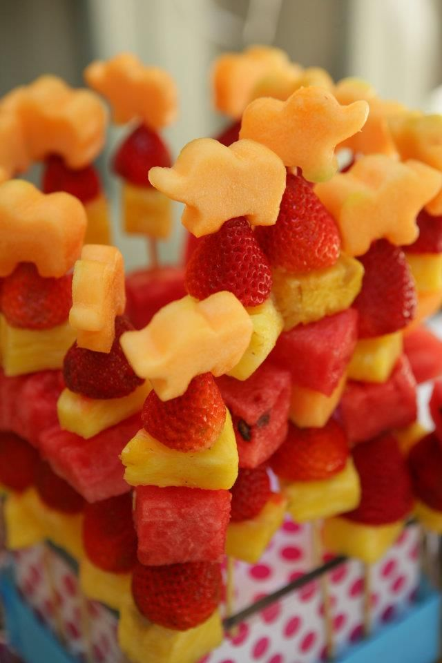 Cute fruit skewers and if displayed like this (or similar), would bring some interest and height to the food table.