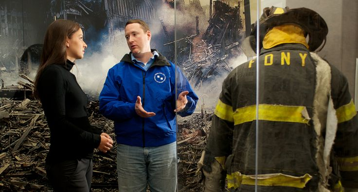 9/11 Tribute Center guide speaks to visitor in the galleries