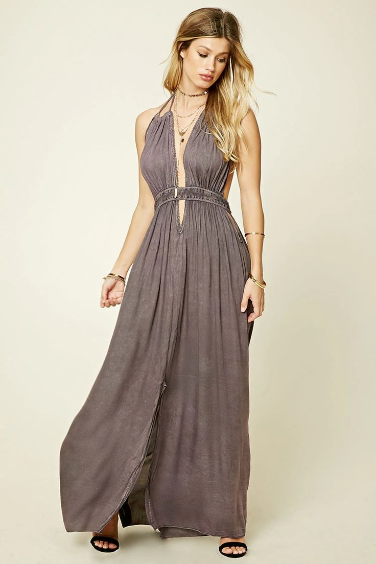 A woven maxi dress by Boho Me™ featuring a crinkled wash effect, self-tie halter neck with braided tassels, scalloped crochet trim along the neckline, a smocked waist, various keyhole cutouts in front and back, and a front slit skirt.