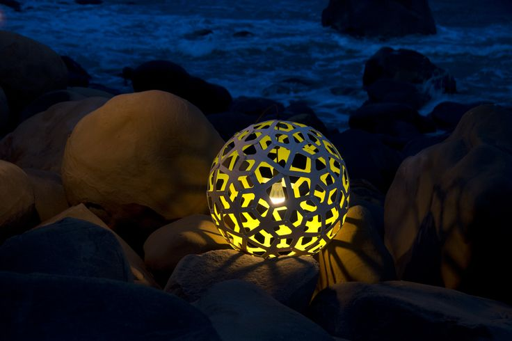Coral is one of our classic wooden pendant lights. Here it is amid a tumble of concretions - spherical sedimentary rocks - on the east coast of New Zealand.