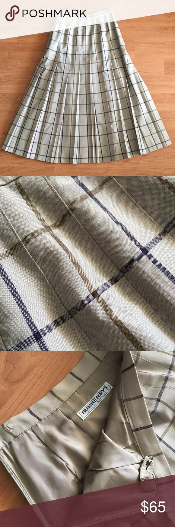 """Burberry England long pleated skirt 100% wool Great Burberry England skirt! Pleated with Side Zipped. Lined. No tag for size but appears to fit size 2. Laying flat: waist- 12"""" length- 32"""". A few tiny blemishes. Thanks! Burberry Skirts A-Line or Full"""