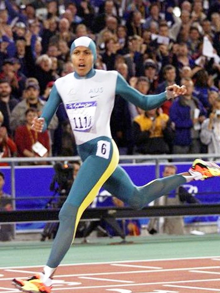 Athlete Cathy Freeman of Australia crosses finish line to win women's 400 metres final at the Sydney Olympic Games. Picture: Gregg Porteous