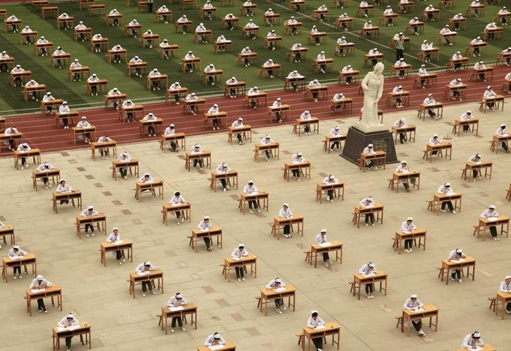 Hundreds of students of the school of nursing take part in an open-air examination at a playground of an vocational college in Baoji, Shaanxi province, China, May 25, 2015. REUTERS/Stringer