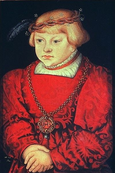 A portrait by Lucas Cranach the Elder of a German youth wearing a wrapped silk flower circlet.
