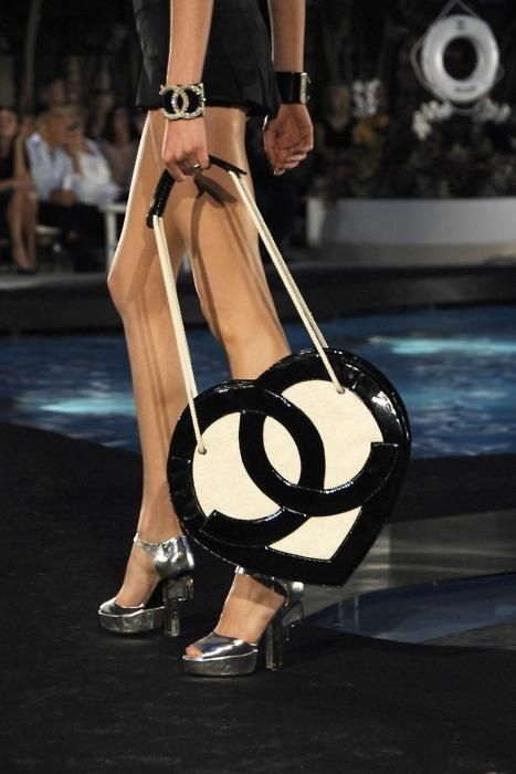 Chanel heart shaped bag with logo in black.