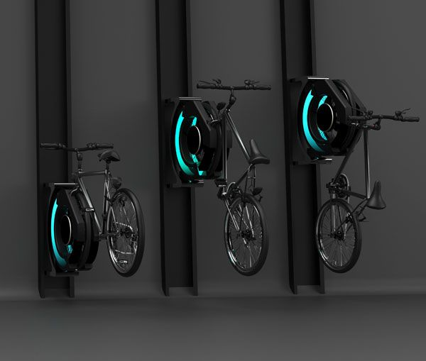 Bicycle Stand.Cyble is a interactive bicycle rack that focuses on spatial savings to secure bikes in public spaces. Users manually push their front wheel into the keyed locking mechanism where it is clamped in place. After being secured, Cyble automatically lifts the bike vertically, keeping it out of harms way and out of the reach of thieves while also saving horizontal space.