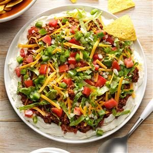 Beefy Taco Dip Recipe -This taco dip is actually a combination of several different recipes I received from friends. I just experimented until I came up with my favorite! It's always a hit, no matter where I take it! —Faye Parker, Bedford, Nova Scotia