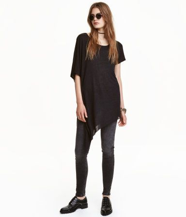 Black. T-shirt in linen-blend jersey with a slightly lower-cut neckline, dolman sleeve at one side, and a raw-edge, asymmetric hem.