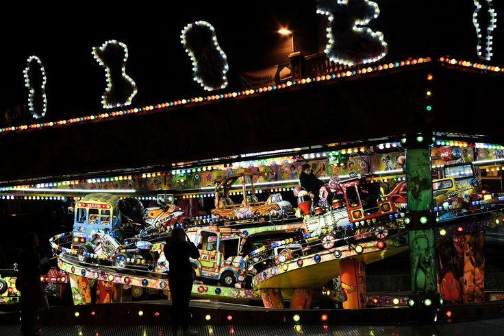 Carousel Fun - Children having fun at the carousel for Christmas.