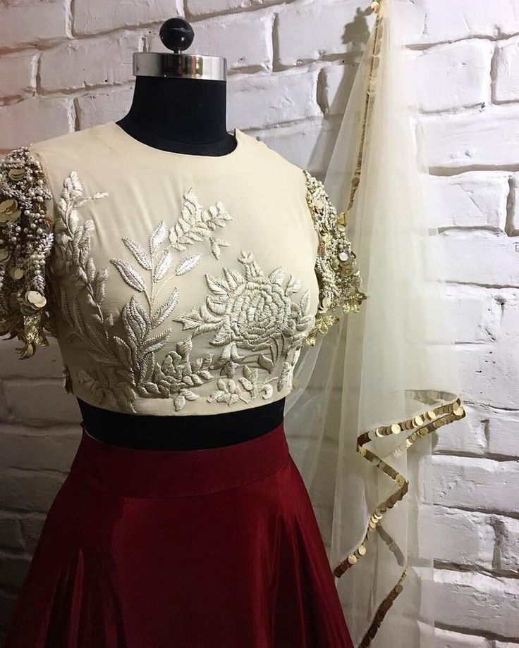 Getting in the festive spirit with Bhumika Sharma upcoming collection. Stunning ivory crop top with floral design hand embroidery hand work on yoke. 27 September 2017
